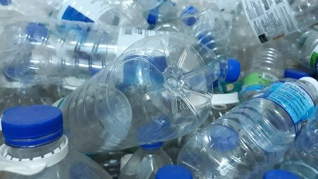 Bottled water bottles in a huge pile
