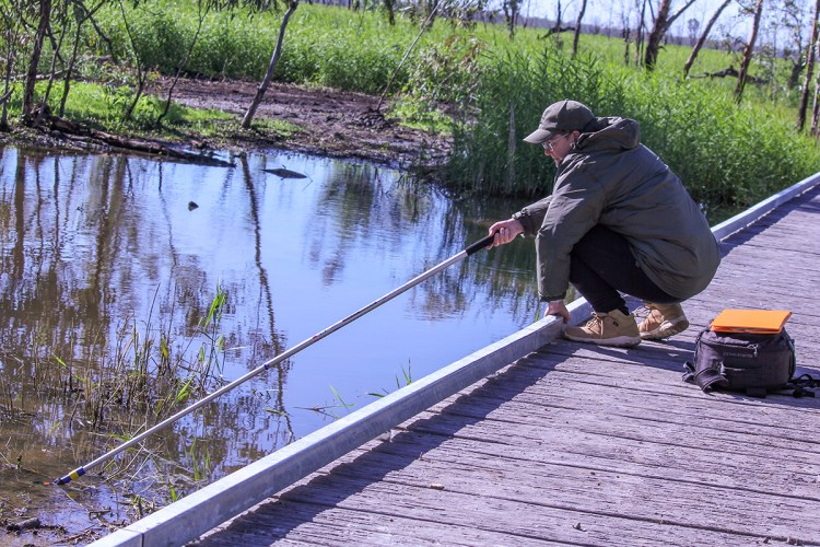 Using a boom to record underwater in one of the lagoons at Burrima