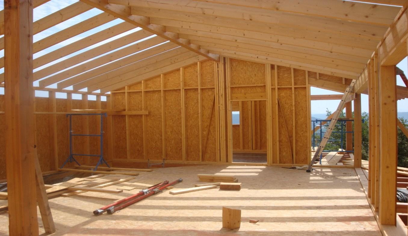 Construction d'une Maison Ossature Bois avec Charpente Traditionnelle à Villeneuve