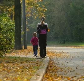 Mother and Daughter Walking in Fall