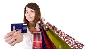 bigstock-Girl-with-bag-and-credit-card--21173042