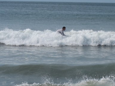 young adults surfing in Malibu beach