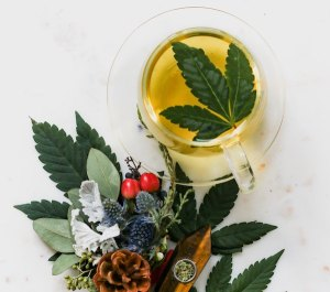A cannabis leaf in a cup of tea