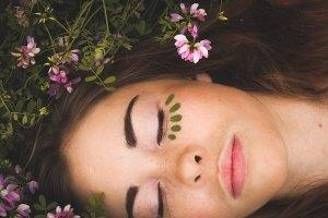 A woman lying amongst flowers
