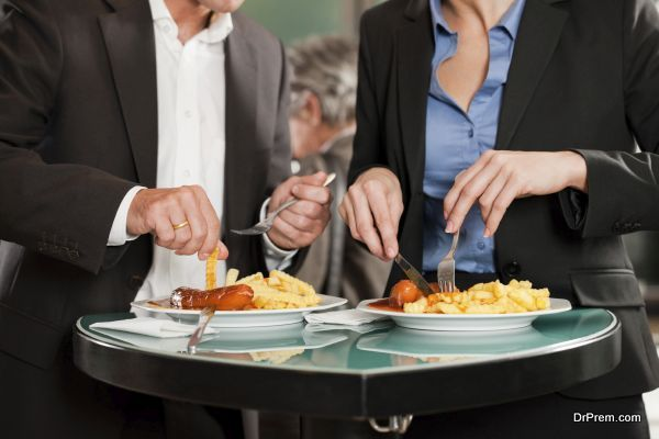 Business People Eating Delicious Food Together