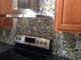 Rainbow mosaics custom blend with recycled aluminum tile accents.