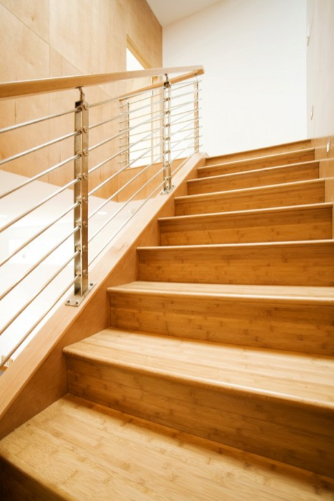Bamboo Stair Treads wiht a Metal Wire Railing = ultra modern.