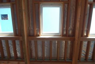 Insulation plus low-E triple glazed skylights - cool inside
