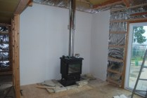 Reclaimed cement-board for heat resistance around stove