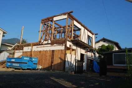 Guest house being pulled down (by hand)