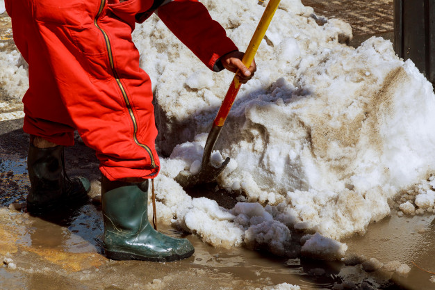 equipment-from-worker-who-sweep-snow-from-road-winter_73110-4054
