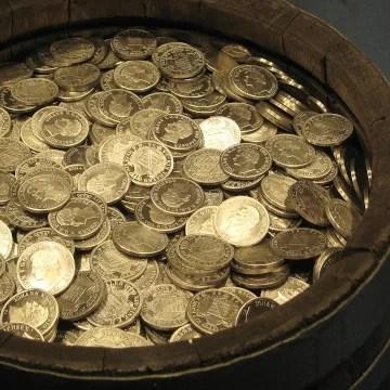Un baril de monnaie symbolisant des économies grâce à un tarif dégressif