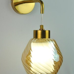 wall light with gold tinted glass on gold finish metal fixture at ECOLIGHT number one light showroom