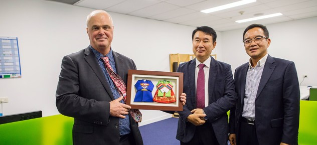 EcoMag Executive Chairman Tony CRIMMINS holds a traditional wedding gift from Mr. Jeong Wook SEO, Senior Vice President, Daejoo-KC Group, with Dr Dae Woong KIM, Director of Research, Daejoo-KC Group. The gift symbolizes the close woking relationship between the two companies.
