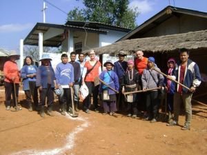 Guests from Germany participating in volunteer activity with villagers at Hloyo village