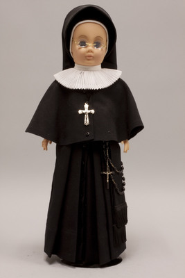 Doll wearing habit worn by Sisters of the Holy Family of