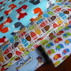 collection of multipad change pads in stack, assorted patterns