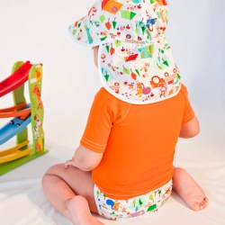 baby wearing bright sun shirt, cloth diaper and sun hat
