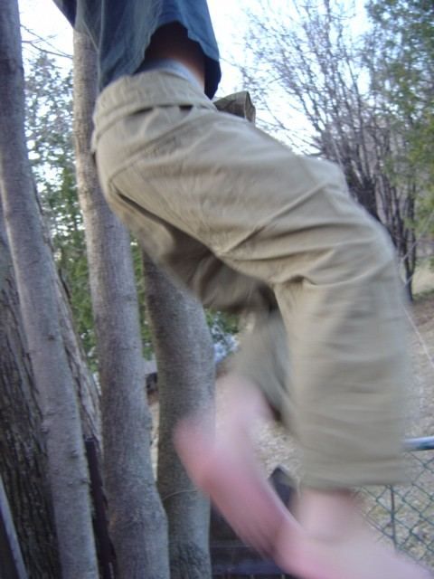 young adult wearing tan siams pants in movement