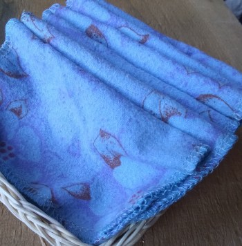 small straw basket filled with blue flannel personal wipes
