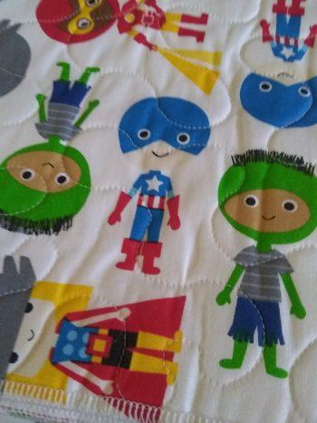 cartoon kids in a variety of superhero costumes
