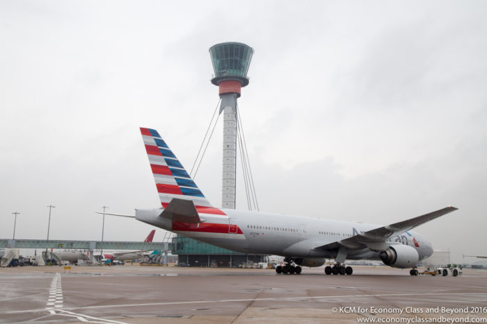 American Airlines Boeing 777 being towed with Heathrow Tower in the background - Image, Economy Class and Beyond
