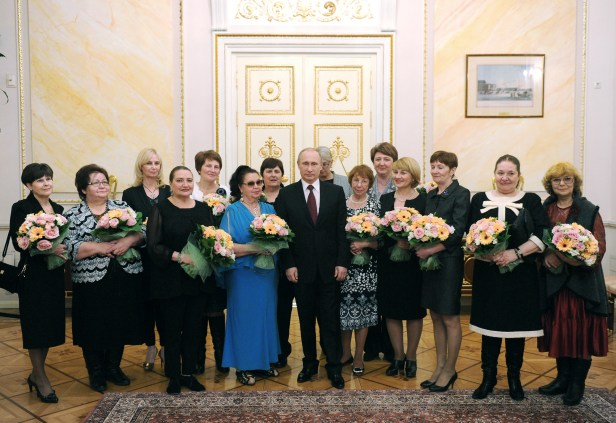 Russian President Putin meets with women to congratulate them on the International Women's Day in Moscow
