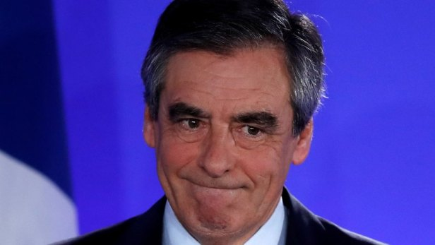 Francois Fillon, member of the Republicans political party and 2017 French presidential election candidate of the French centre-right, reacts as he delivers a speech at his campaign headquarters in Paris