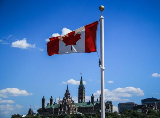 canada-flag-over-parliament