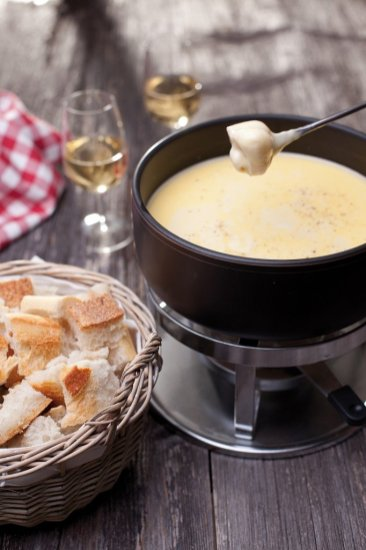 Switzerland Fribourg Region: The famous cheese Fondue 'moitie-moitie' (half-half) is served in many local restaurants.