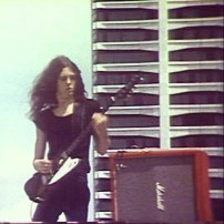 Allen Collins and his Gibson Firebird in front of the Gulf Tower, Earth Day 1971