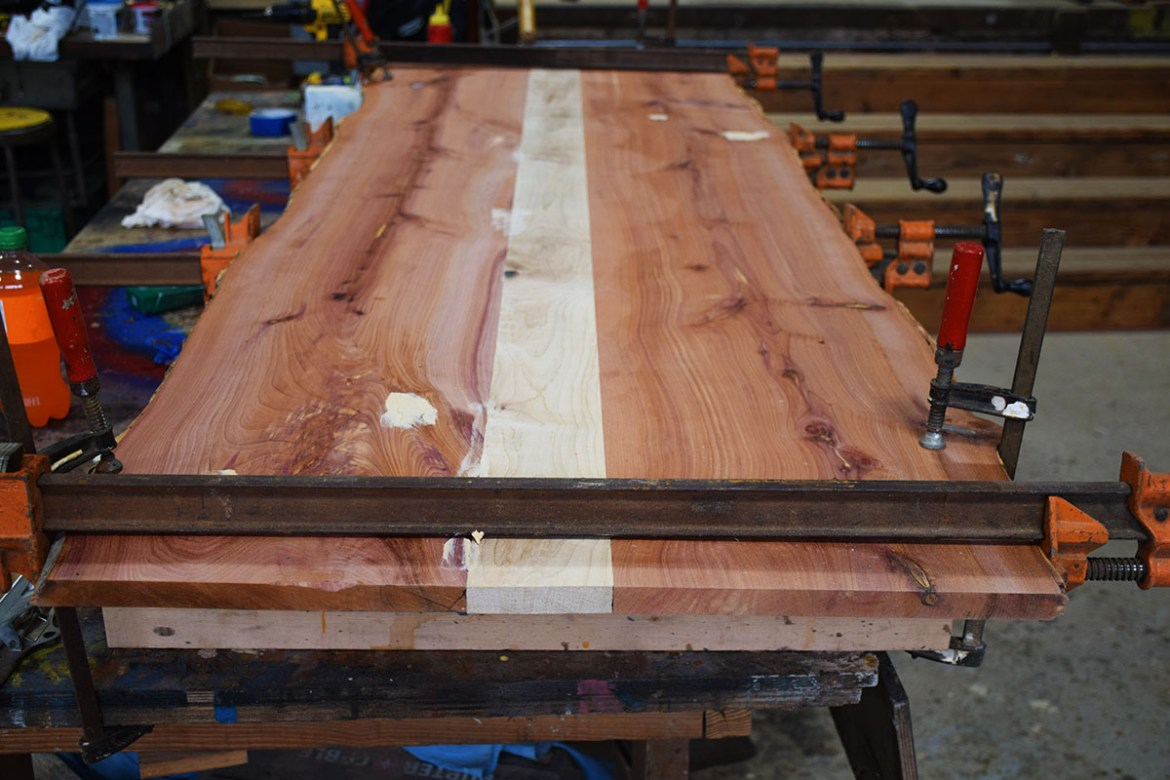 The table top ends are trimmed and voids are filled in.