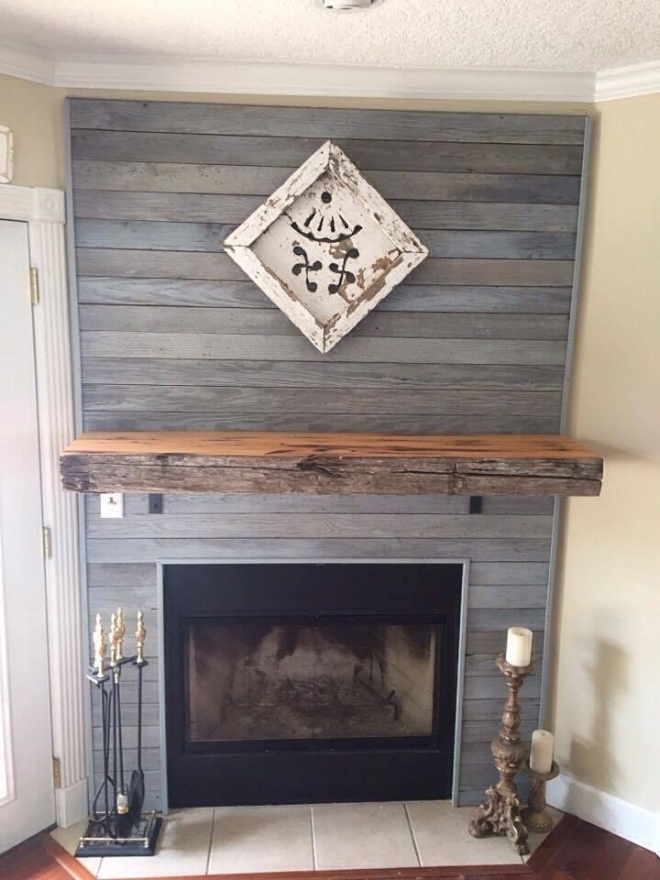 Salvaged Barn Wood accent wall and beam mantel