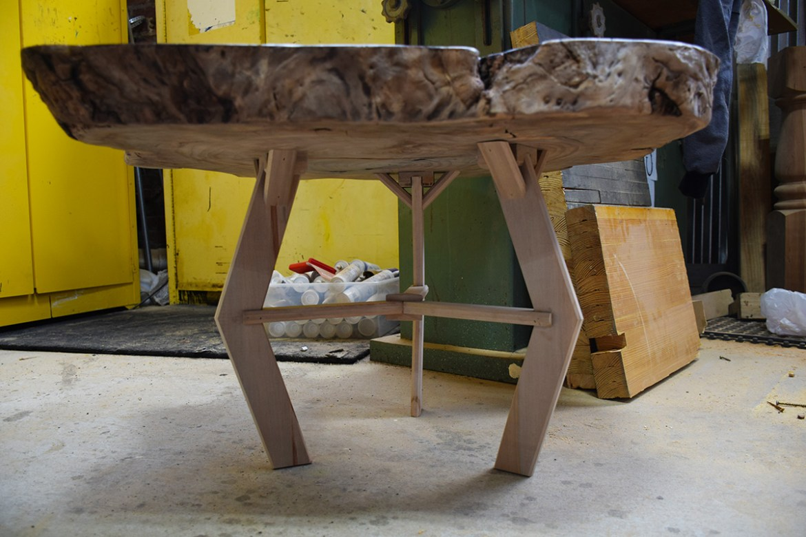 The legs have now been attached to the custom cookie slab table.!