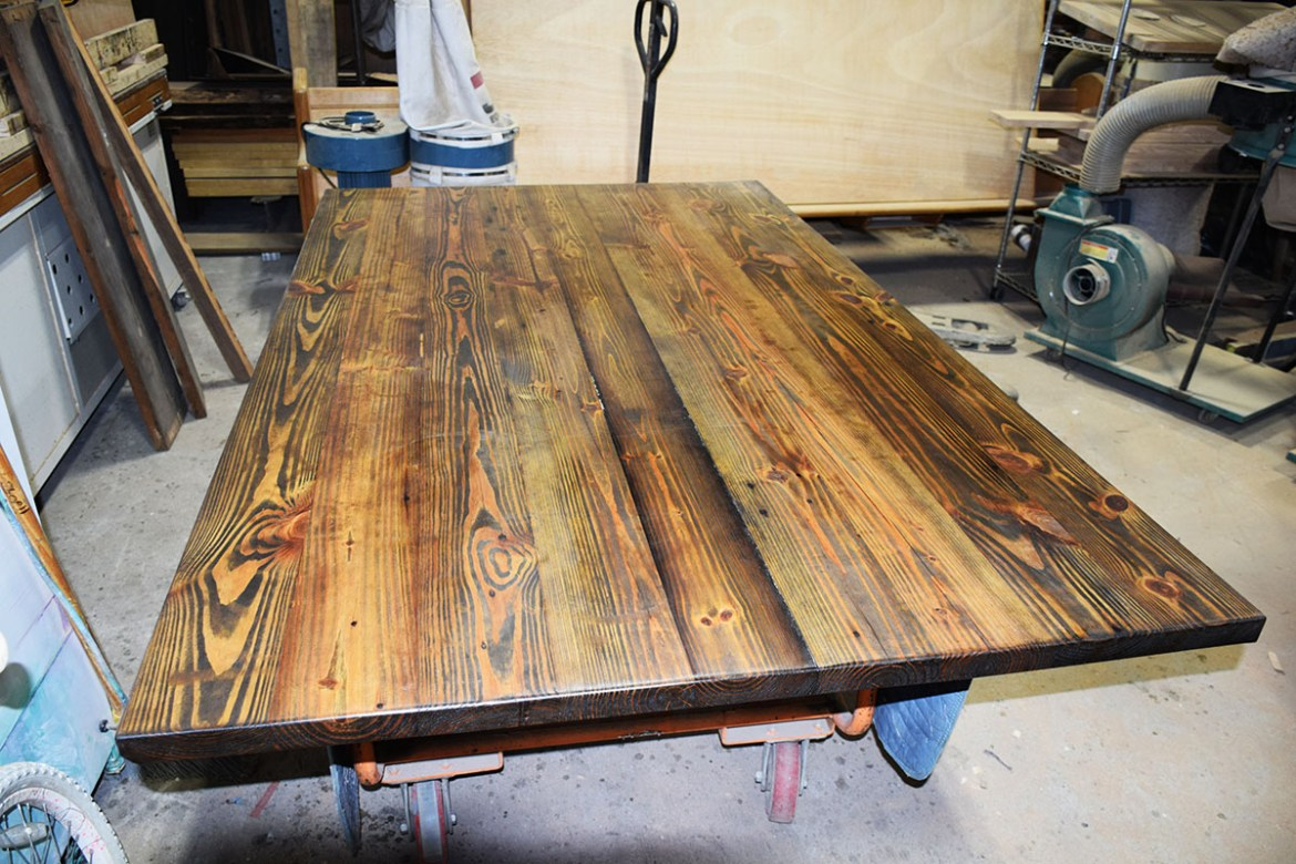 Salvaged South Georgia heart pine is joined and first coat applied.