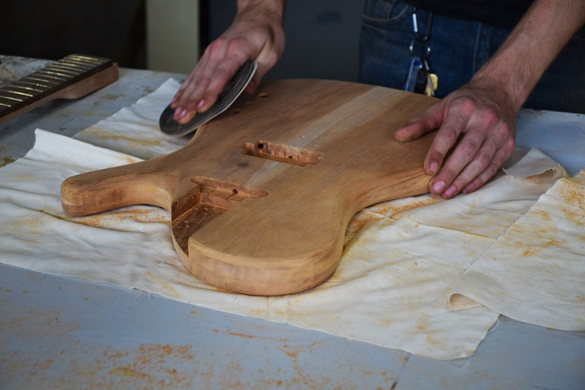 Here's Chris hand sanding and shaping the beautiful Mahogany body.