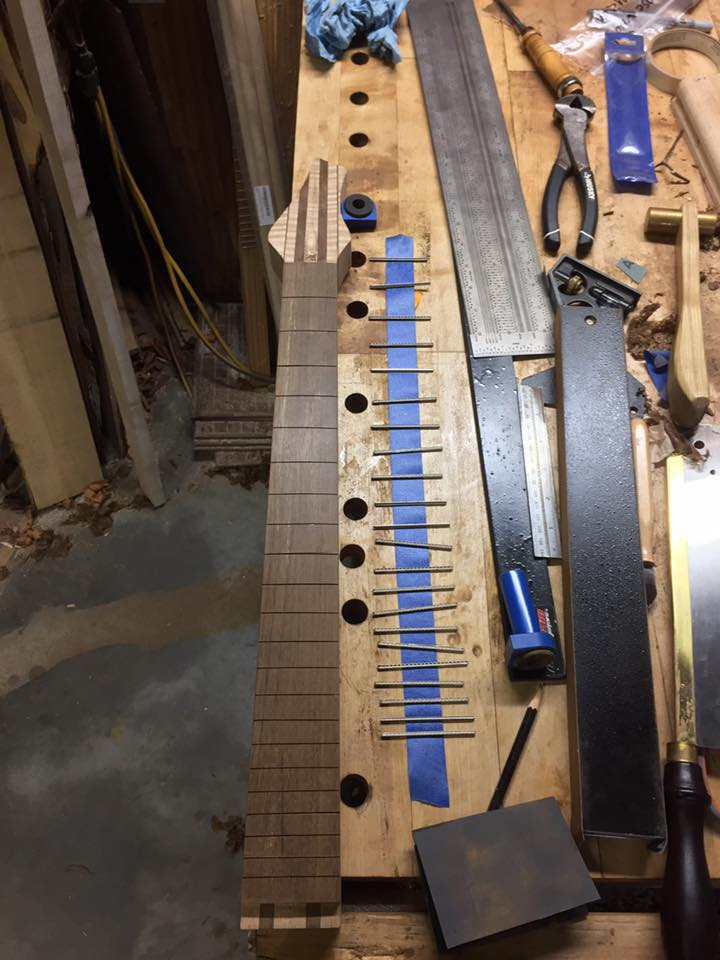 The frets have been cut, laid out and ready to pressed into the Amazonian Rosewood fretboard.