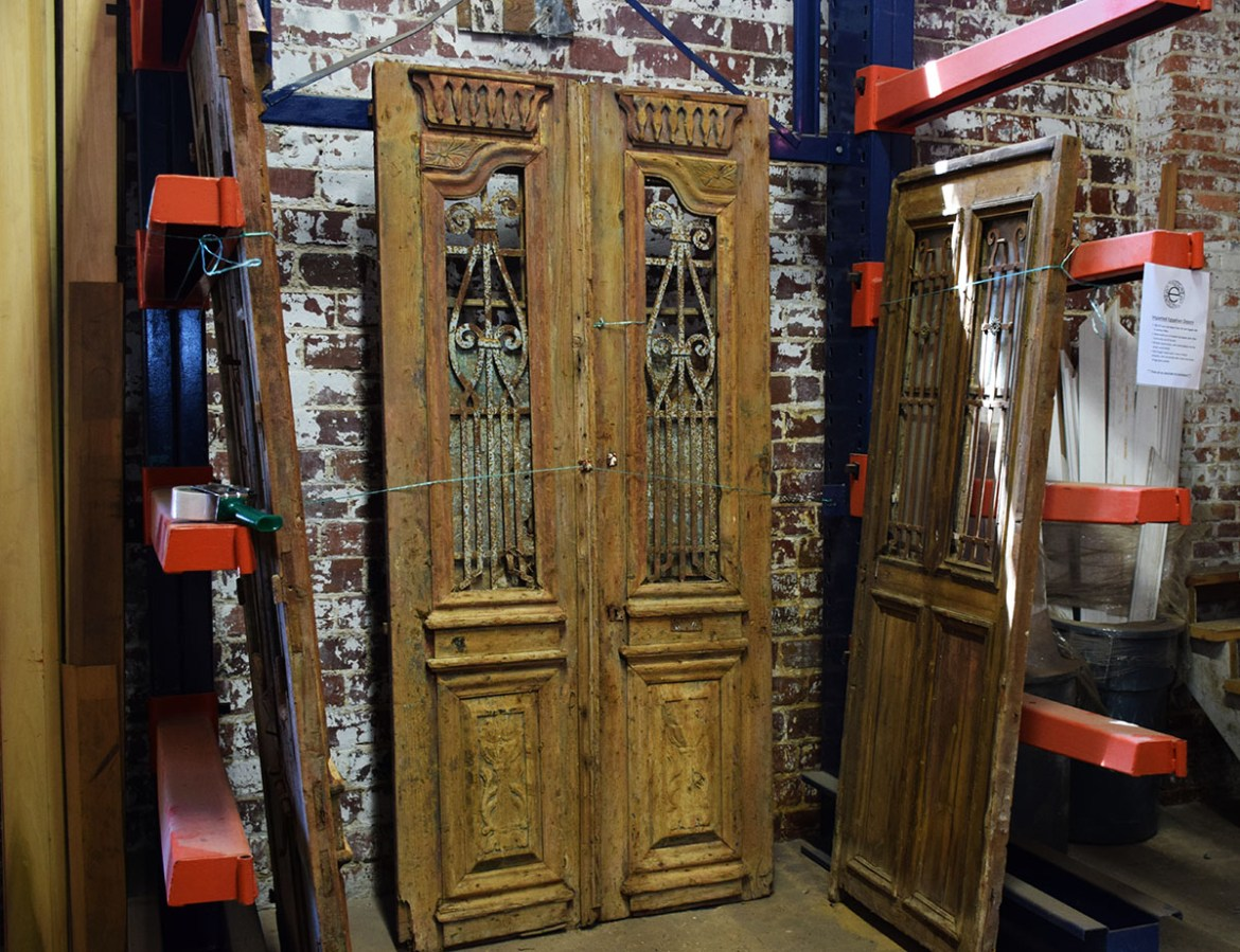 All of these doors have handcrafted details, raised panels and iron work inserts.