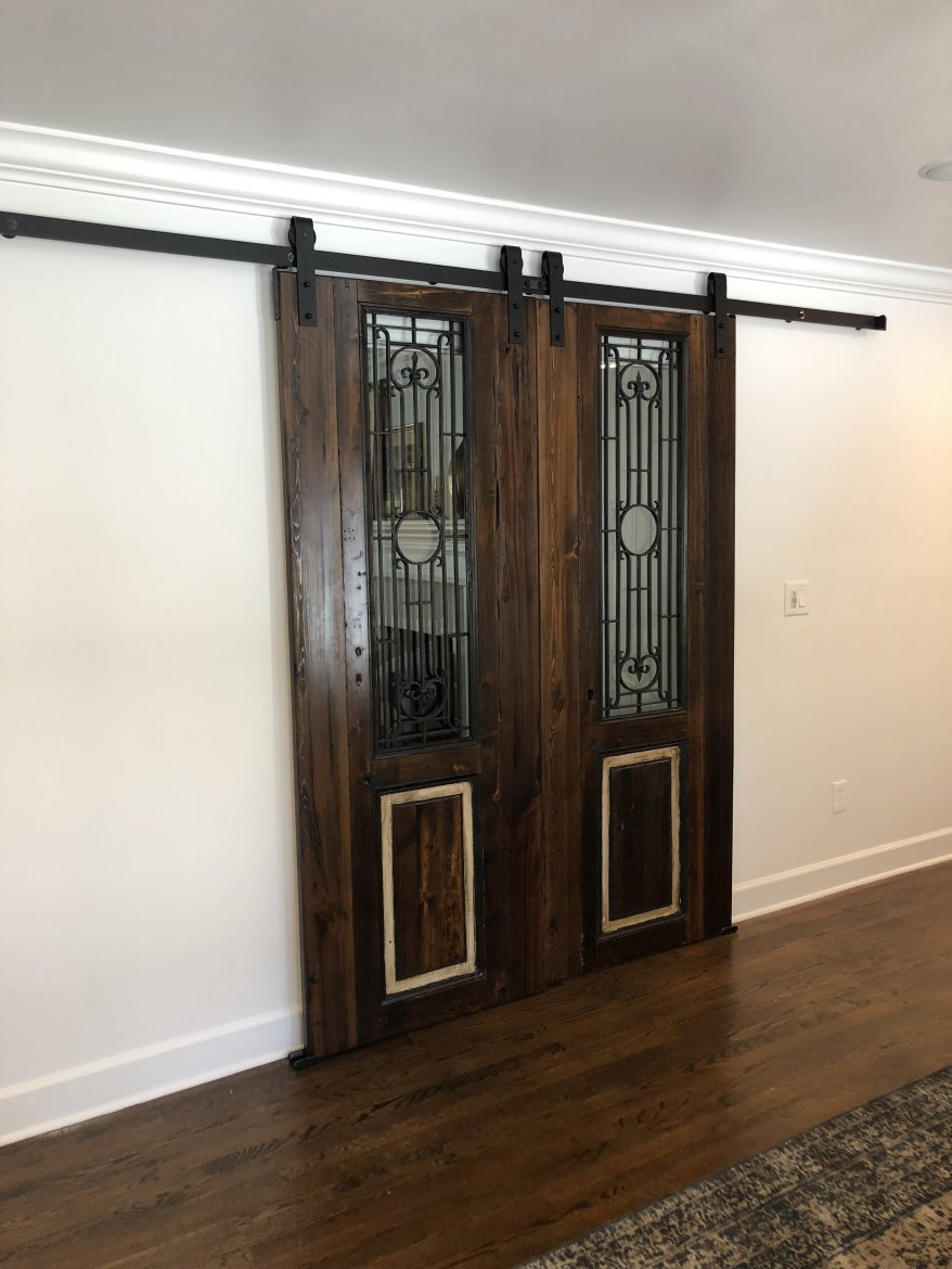 Egyptian 'Barn Doors' in their new home add an awesome accent to the room.