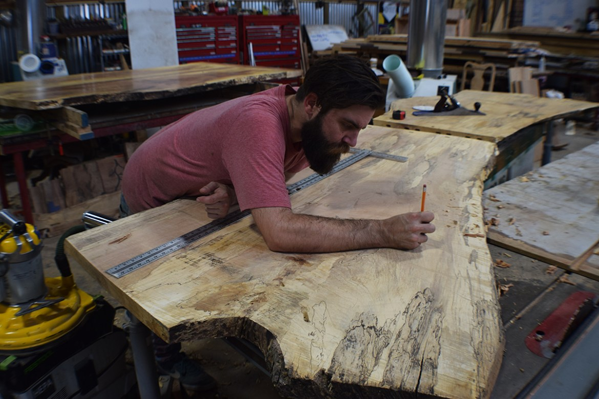 Parker takes great care using precise measurements to match the slabs.