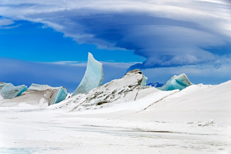 Icy landscape with cloud formation above