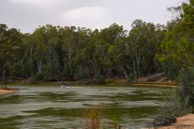 A small motor boat on a river bend