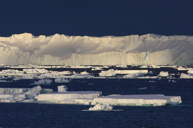 Totten Glacier viewed from ship with ice floes in foreground