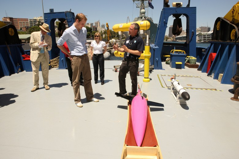 People on ship's deck with scientific equipment