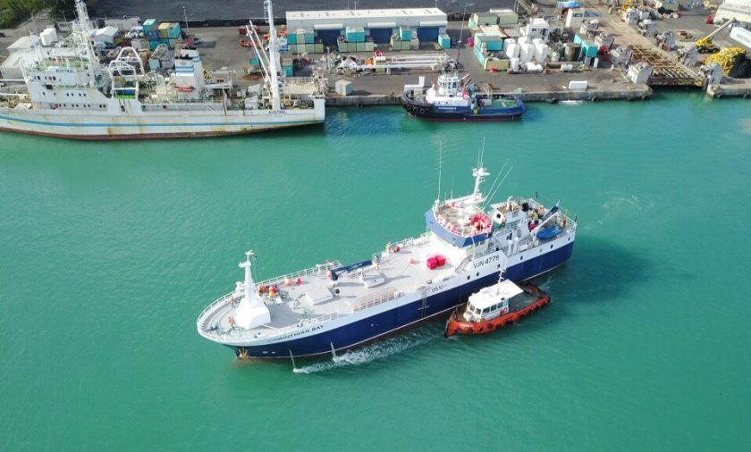Drone image of a fishing vessel in port