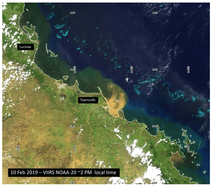A satellite image of the coast of Queensland near Townsville. A brown plume swirls into the blue/green water near the coast at the mouth of the Burdekin River.