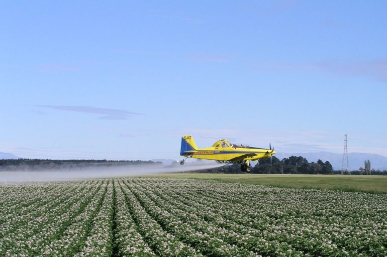 Crop dusting chemicals on to a field