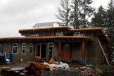 Consulting, rough in plumbing, roof membrane install, and cob work for the Gabor load bearing cob home