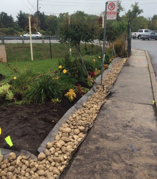 ditch-along-sidewalk-filled-with-rock