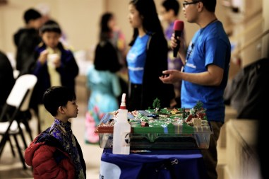 Kid inspecting the watershed model, which illustrates the impacts of stormwater pollution. Photo Credit: Sam Le.